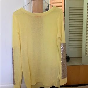 Very light Weight  yellow and gold arms sweater.